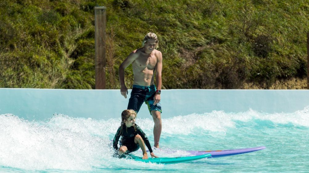 parent and child wave pool surfing