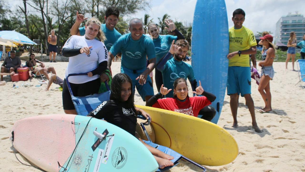 adaptive surfers at the beach