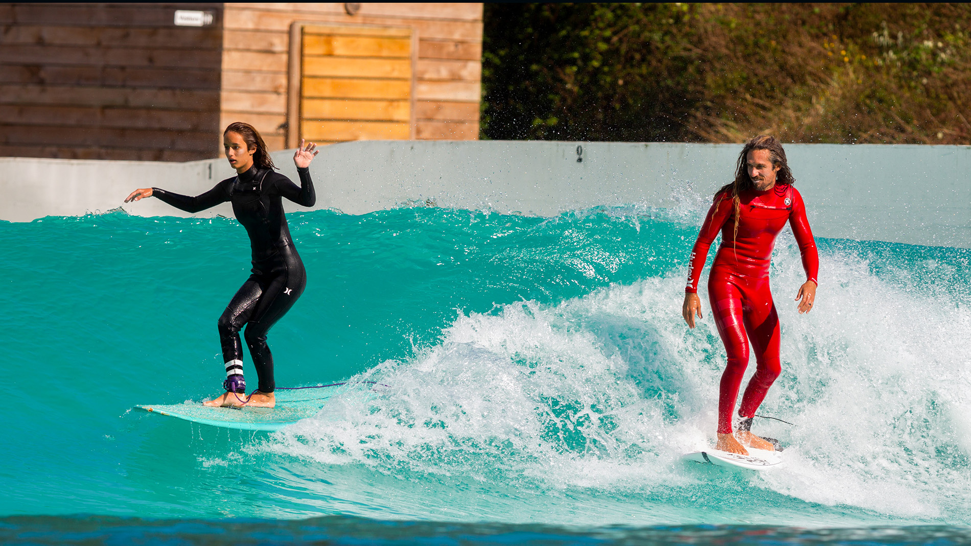 Rob Machado and daughter surf wave pool together
