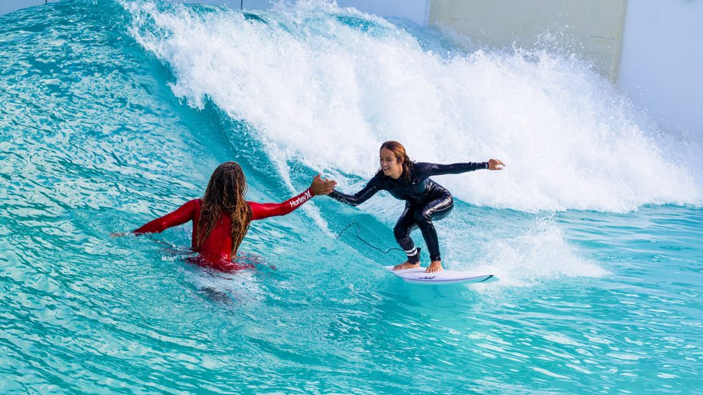 Rob Machado and daughter high-five at the Wavegarden Cove R&D facility in the Basque Country. Photo by