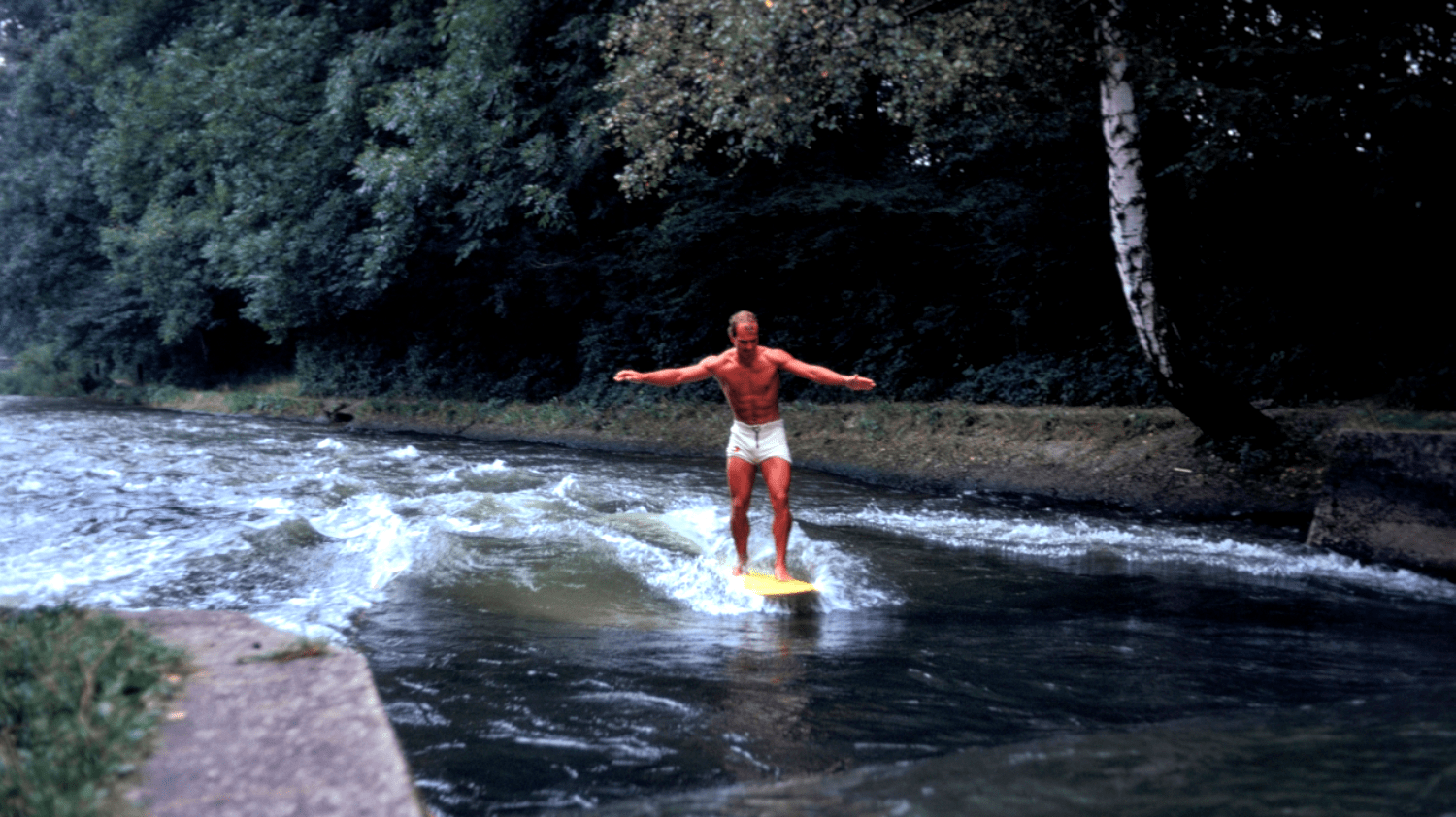the first-ever photo taken of a surfer riding a rapid in Munich