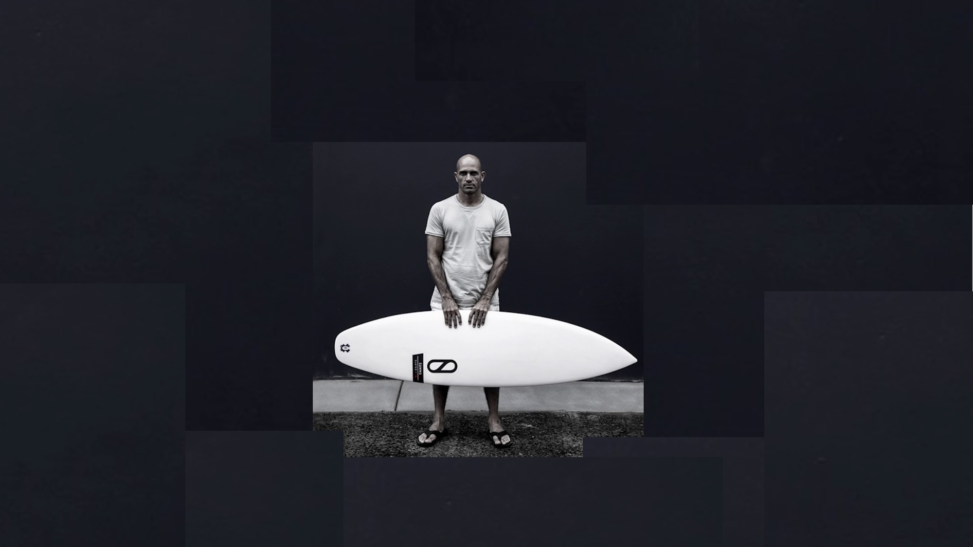 kelly slater with surfboard